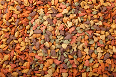 Dry cat dog food in granules. Colorful dry cat dog food in granules. Pet treats of different shapes and colors, view from top above overhead. Copyspace for text stock photography