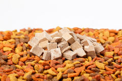 Dry cat dog food in granules. Pile heap of pet treats, dried chicken liver on white background Stock Photos