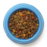Dry cat food in blue bowl isolated on white from above. Stock Photo