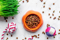 Dry cat food in bowl on stone background top view Stock Images