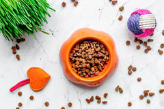 Dry cat food in bowl on stone background top view Royalty Free Stock Photo
