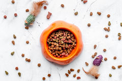 Dry cat food in bowl on stone background top view Stock Photography