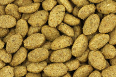 Dry cat food brown background Royalty Free Stock Photo