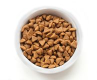 Dry cat food in a ceramic bowl Royalty Free Stock Image