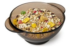 Dry cereal in a black bowl Royalty Free Stock Images