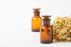 Dry chamomile and bottles Stock Photography