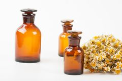 Dry chamomile and a bottles Royalty Free Stock Photos