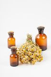 Dry chamomile and a bottles Royalty Free Stock Image