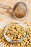 Dry chamomile in a glass dish Stock Photography