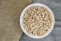 Dry chickpea pictures in the bowl over the wooden floor, ready to cook dried chickpeas dish Royalty Free Stock Photography