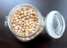 The dry chickpeas in a glass jar Stock Images
