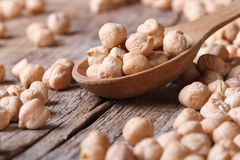 Dry chickpeas in a spoon closeup and scattered horizontal Royalty Free Stock Photography