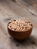 Dry chickpeas in a wooden bowl Royalty Free Stock Image