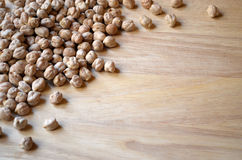 Dry chickpeas on wooden cutting board. With space Stock Image