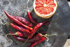 Dry chili and fruit Royalty Free Stock Photos