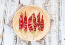 Dry chili papper in wooden plate Stock Photos