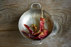 Dry chili pepper. On the wooden background Royalty Free Stock Photo