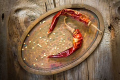 Dry chili pepper. On the wooden background Stock Photos
