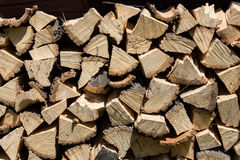 Dry chopped firewood logs in a pile Stock Photo