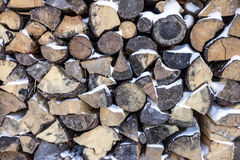 Dry chopped firewood logs in a pile Royalty Free Stock Images