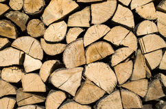 Dry chopped firewood logs in a pile Stock Image
