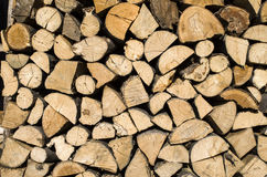 Dry chopped firewood logs in a pile Stock Images