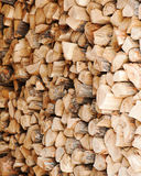Dry chopped firewood logs in a pile. Royalty Free Stock Images