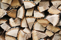 Dry chopped firewood logs in pile. Royalty Free Stock Photography