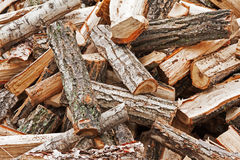 Dry chopped firewood logs in pile. Stock Photo