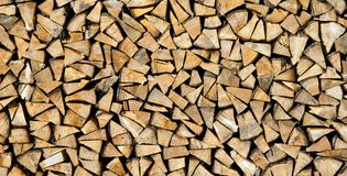 Dry chopped firewood logs ready for winter as background or texture. Stock Photo