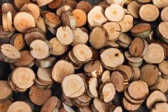 Dry chopped firewood logs stacked up on top of each other in a pile. Textured wooden background royalty free stock photography