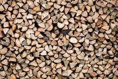 Dry chopped firewood stacked up in a pile Stock Image