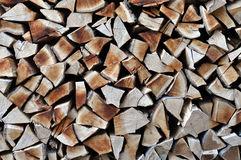 Dry chopped firewood in storage ready for use in cold winter sea Stock Photo