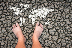 Dry clay land foot the world map shows the drought. Royalty Free Stock Photos