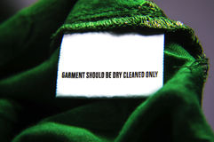 Dry clean only cloth. Dry clean only instructions for cloth washing. White tag on the cloth royalty free stock photography