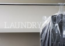 Dry-Cleaning Laundromat With Men Shirts On Hanger. Ironed And Packed Men Shirts Hanged On Rack Stock Images