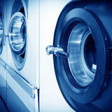 Dry-cleaning machines. Public laundry machines standing in a row royalty free stock photography