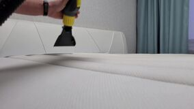 Dry cleaning of the mattress. Dry cleaning at home.Close-up