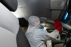 Dry cleaning salon cars. Worker uses washing vacuum in the car