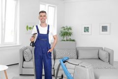 Dry cleaning worker with professional apparatus. Indoors Royalty Free Stock Photos