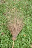 Dry coconut stick broom on grass ground Stock Photography