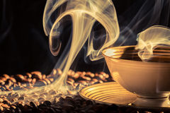 Dry coffee with blue smoke Stock Photos