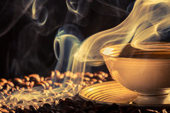 Dry coffee with blue smoke Royalty Free Stock Photos