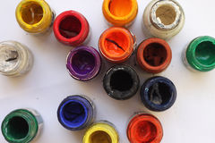 Dry colorful poster color pots on white background. Top view of dry colorful poster color pots on white background Royalty Free Stock Image