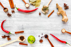 Dry colorful spices, chili pepper on kitchen light table background top view mockup Stock Image
