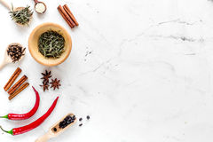 Dry colorful spices, chili pepper on kitchen stone table background top view mockup Stock Images