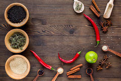 Dry colorful spices, chili pepper on kitchen wooden table background top view mockup Stock Image