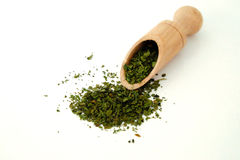 Dry coriander spice in a wooden spoon. On a white surface Royalty Free Stock Photo