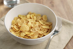 Dry corn flakes for breakfast in bowl on table Royalty Free Stock Photography
