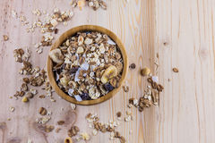 Dry corn flakes and muesli and glass of milk on the table. Top view. Dry corn flakes and muesli on the table. Top view Royalty Free Stock Photos